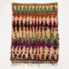 marokkansk-boucherouite-taepper-haendlavet-i-tekstiler-med-groen-lilla-beige-mønster